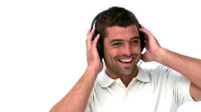 stock-footage-glad-man-listening-music-against-a-white-background