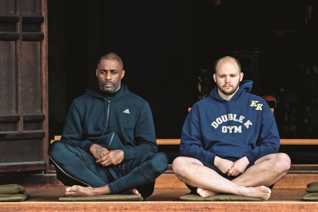 Idris Elba and trainer Kieran Keddle participate meditation at Kennin-ji Temple in Kyoto, Japan, on March 20, 2016.