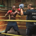 Idris Elba warms up before his first fight at the Repton Club in London.